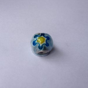 1 White glass charm