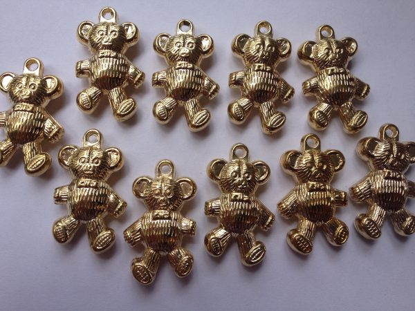 10 Gold coloured teddy bears