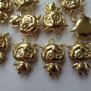 10 Gold girl charms/pendants