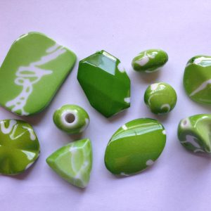 10 Green beads white markings