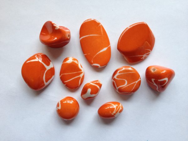 10 Orange beads white markings