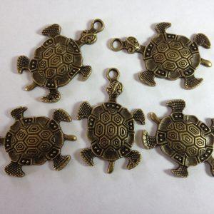 8 Metal pig charms