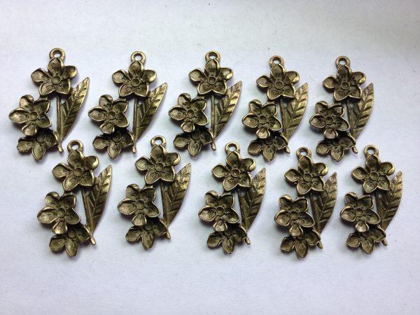 10 Bronze flower pendants